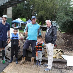 Georges River Council Mayor Kevin Greene (right) with Ian Thomson from Ocean Crusaders (middle) and Rob Dixon from Georges Riverkeeper (left) with kids at the Paddle Against Plastic community event.