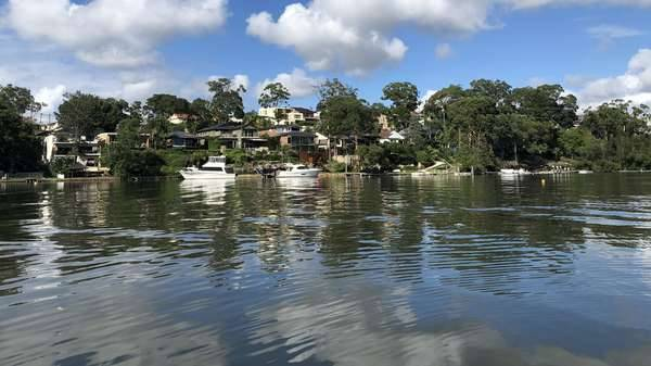 Coastal Management Plan is a long term strategy for managing the coastal zone, image shows small boats moored outside houses on the Georges River