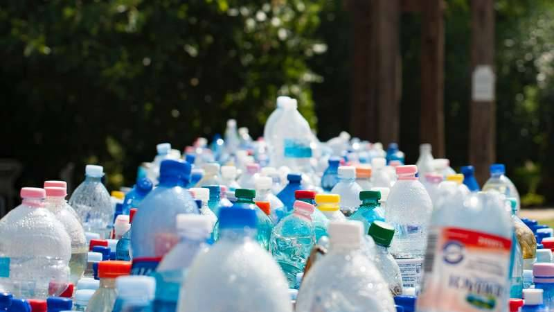 A group of plastic bottles collected to be returned for money as part of the Container Deposit Scheme in NSW otherwise known as Return and Earn.