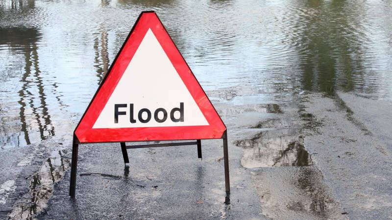 Flood sign warns people not to enter floodwaters