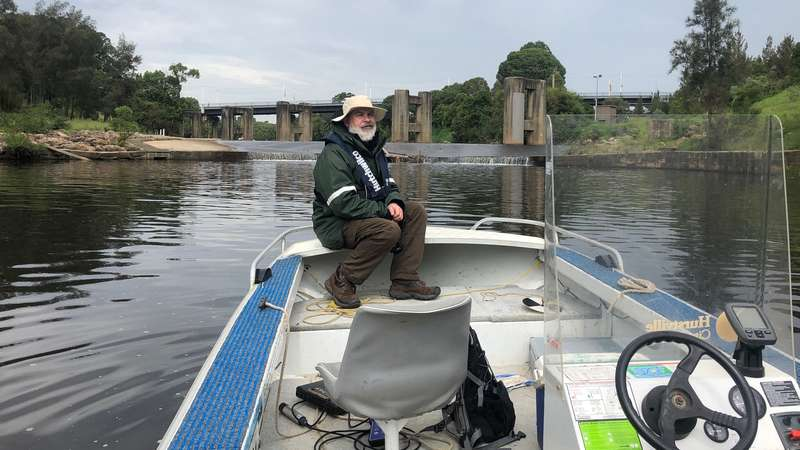Dr. Dave Reid, on the Georges Riverkeeper boat, undertaking river health monitoring
